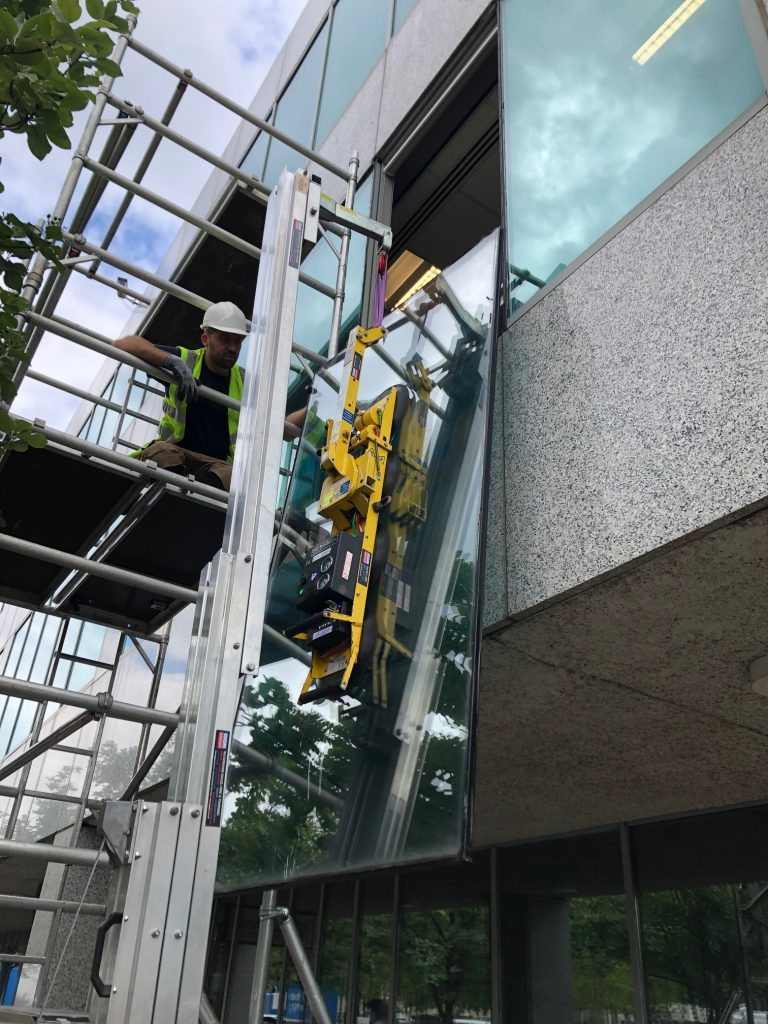 Changing first floor window with scaffold and crane